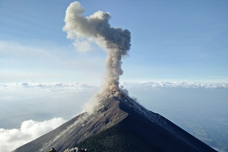 A volcano with smoke coming out